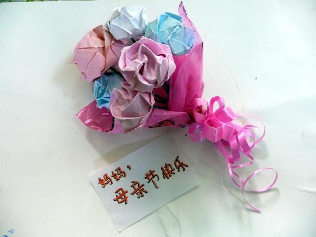 儿童彩纸折花的步骤图片