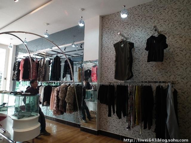 服装店墙纸装修效果图,女服装店背景墙效果图,2013女服装店